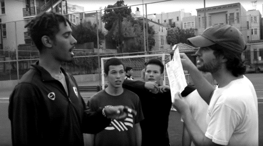 A 'Tech Bro' in San Francisco claiming the right to use the soccer pitch by virtue of his possession of a permit. The local youth reject this claim.